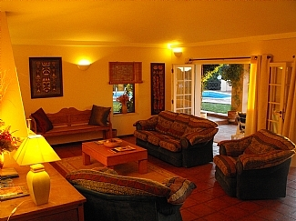 lounge leading onto terrace, pool, ocean views